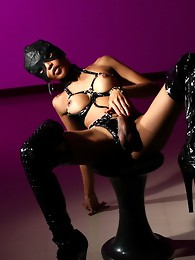 Naughty Nit posing in mask and long boots