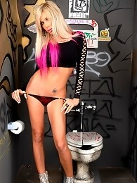 Alluring transsexual posing in the toilet
