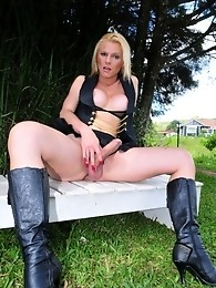 Sexy transsexual exposing her cock outdoors