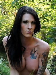Busty brunette Morgan Bailey posing in the wild