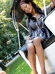 Ebony shemale posing in a hotel room
