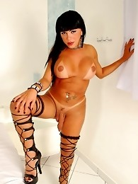 Hot brunette tgirl posing her huge tits and cock